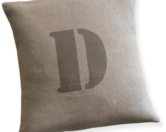 Linen pillow cover with a letter