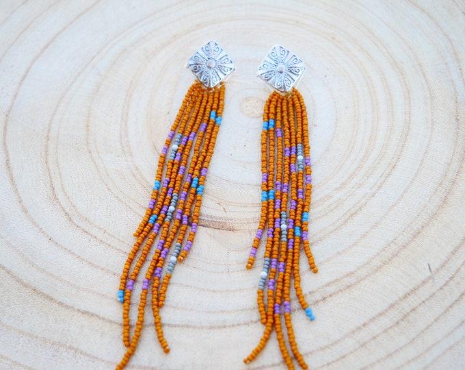 Desert fringe earrings dangling off a silver diamond shaped setting, Stud earrings