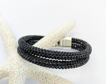 Black Crystal encrusted bracelet with magnetic clasp. Fits wrist size 6 1/2.
