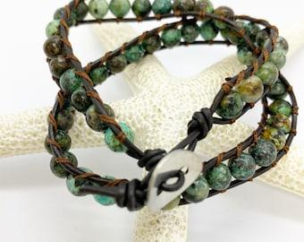 Double wrap bracelet featuring speckled Jasper with button closure