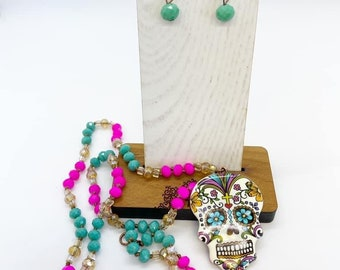 30 inch beaded sugar skull necklace with coordinating earrings.