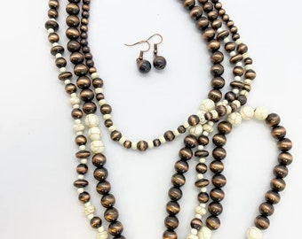 Triple strand necklace with coordinating earrings. These beads are wood and lightweight but they look like copper and howlite stone