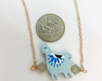 """Blue llama necklace with Swarovski crystals on 18"""" rose color stainless steel chain."""