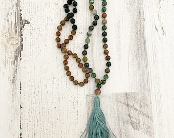 Earthtone beaded necklace with green tassel featuring lava beads genuine stones and wood