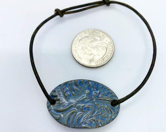 Ceramic bracelet on adjustable leather cord