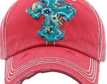 Tattered baseball hat with floral cross patch