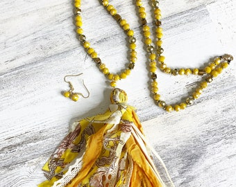 Bright yellow beaded tassel necklace with matching earrings