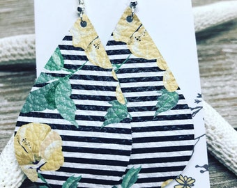 Genuine leather teardrop earrings with black and white stripe and yellow floral pattern. Please allow for floral pattern variations