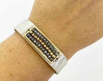 Metallic leather cuff bracelet with bead accents and adjustable snap closure