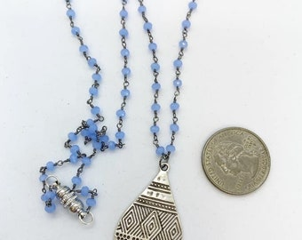 20 inch rosary style chain with pewter pendant and magnetic clasp.