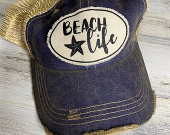 Beach life tattered trucker hat with snap closure