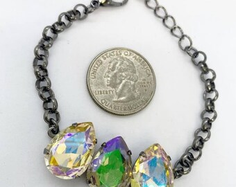 Gun metal chain link bracelet with three 18mm pear-shaped Swarovski crystals