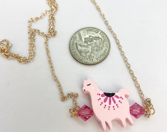 """Pink llama necklace with Swarovski crystals on 18"""" rose color stainless steel chain."""