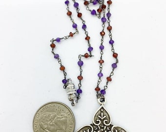 18 inch Garnet and amethyst rosary style chain with pewter pendant and magnetic clasp.