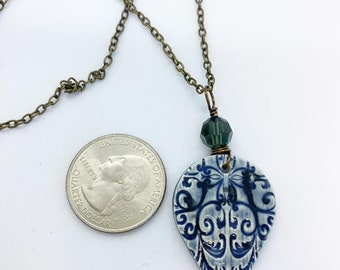 Blue ceramic pendant wire wrapped with Swarovski crystal on 18 inch chain