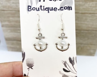 Silver tone anchors with pearl accent