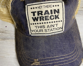 Train wreck tattered trucker hat with snap closure