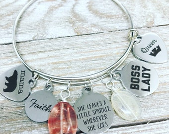 Mama bear, boss lady, queen, faith and she leaves a little sprakle laser charm bracelet featuring salmon and pineapple quartz.