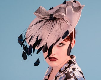 Sinamay saucer hat with contrasting bow and stripped coque feather embellishment