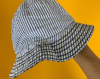 4ef6e4bf47e16 Skateboarding brand Domestics bucket hat new without tags. Reversible,  stripes and plaid