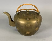 An antique Chinese brass teapot with applied medallions, late Qing Republic period