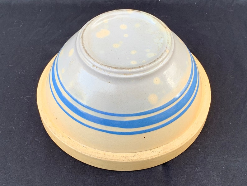 An antique banded yelloware mixing bowl