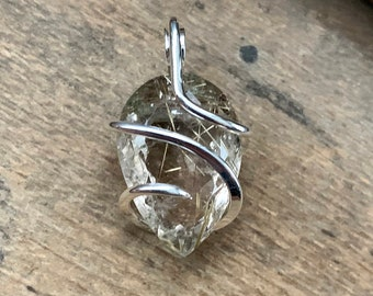 Faceted rutilated quartz in polished sterling silver pendant