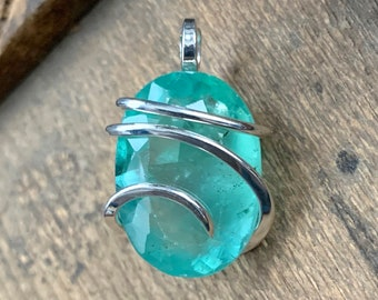 Faceted fluorite in forged sterling silver pendant