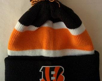 designer fashion 1e156 4ff04 ... where to buy cincinnati bengals applique logo on a knit cuffed beanie  pom hat cap.