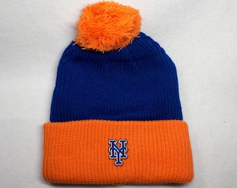 0b1247aa New York Mets Heat Applied Logo, on a Knit Cuffed Ribbed Beanie POM hat cap.  Royal Blue/Orange Unisex Adult! Good quality! Adult 1 size