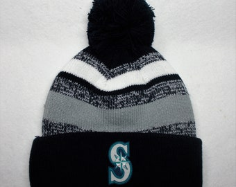 the latest 25f43 e8d74 ... inexpensive seattle mariners heat applied logo on a knit cuffed beanie  pom hat cap. navy