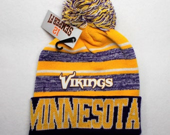 99e310012c1 Minnesota! With a Heat Applied Logo On a Knit Beanie POM hat cap!  Purple Gold Wht! Great quality. Adult Unisex! Sideline Look Beanie!