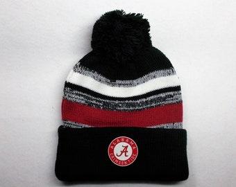 factory authentic 3dc1f 0a1d0 ... australia alabama crimson tide heat applied logo on a knit cuffed beanie  pom hat cap. get mens nike crimson alabama crimson tide sideline ...