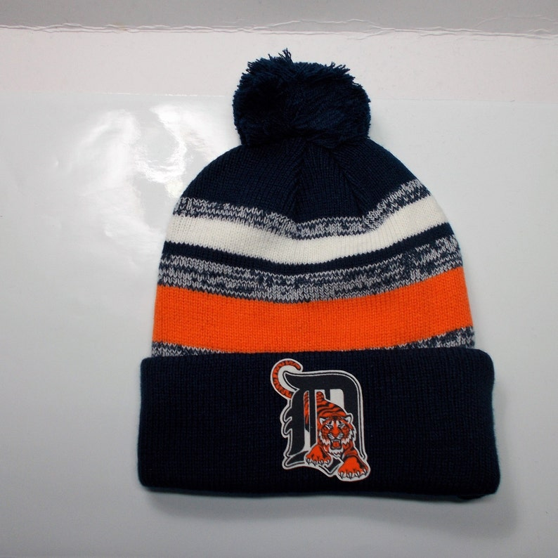 23ef22d202a Detroit Tigers Heat Applied Logo on a Knit Cuffed Beanie POM
