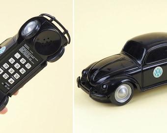 Vintage analog VW Beetle phone Columbia telephone VW 328. Retro black desk analog phone for home decoration. Split window bug. Volkswagen T1