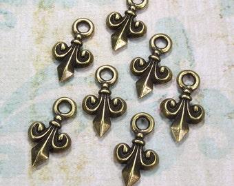 Tiny Fleur De Lis Brass Charms, TierraCast, 4 Charms - Item 945