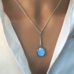 Opal pendant etsy long blue opal pendant necklace oval cabochon opal set in 925 sterling silver ref aep5002 aloadofball Images