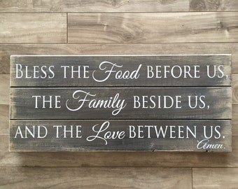 Bless the food before us, the family beside us, and love between us wooden sign