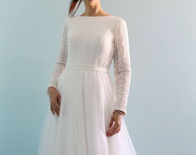 Another Addition to our Winter 2017 Collection. Bohemian Style Long Sleeve Lace Wedding Dress with Stunning open Back and Tulle Skirt