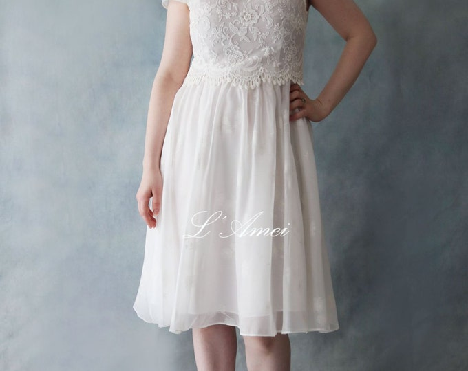 Sweet scoop neckline Tea Length A-line Party Dress with Embroidered Lace Bodice and Cap Sleeves. Great for Wedding Party little white dress