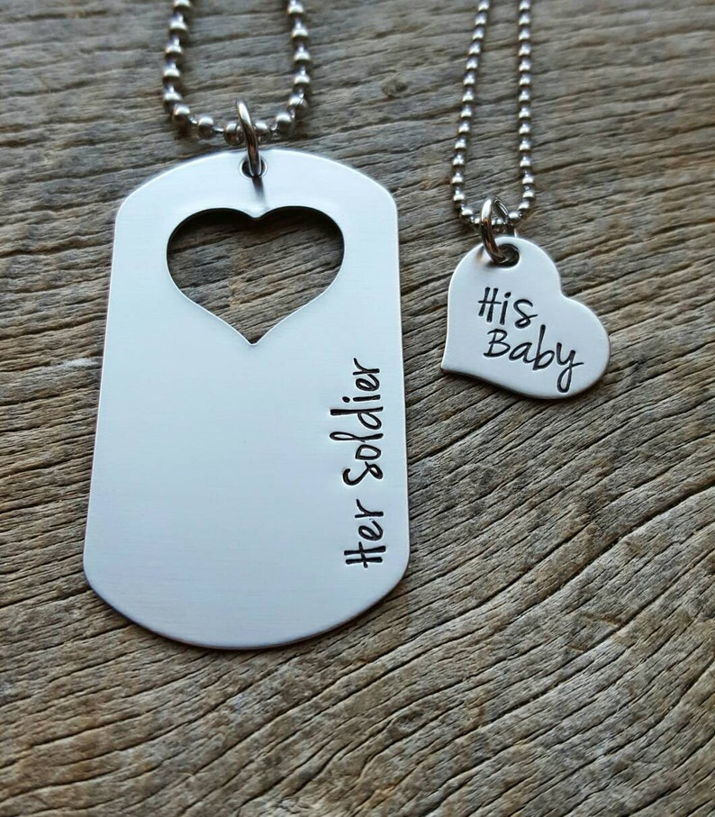 Hand stamped dog tag with cut out heart his and her