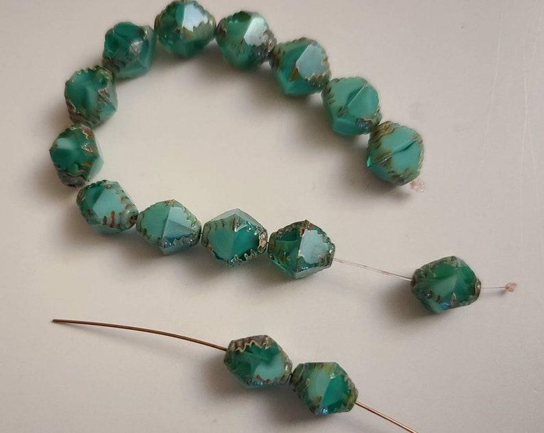Ten Faceted 8x10mm Bicone Sea green Czech glass beads