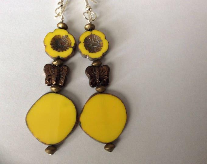 Yellow Czech glass earrings. Flower with copper glass butterfly.