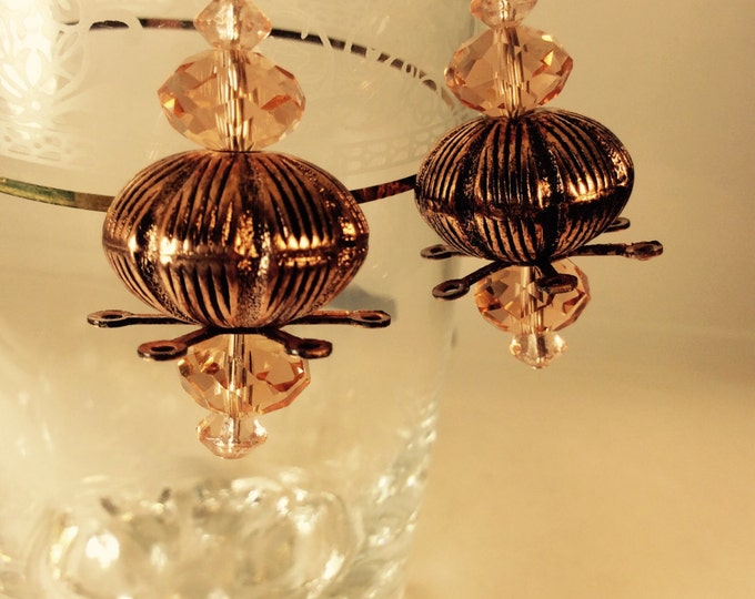 Earrings, dangle, pink crystal and metalized copper plastic