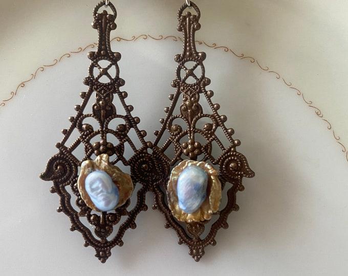 Long dangle filigree earrings with pearls