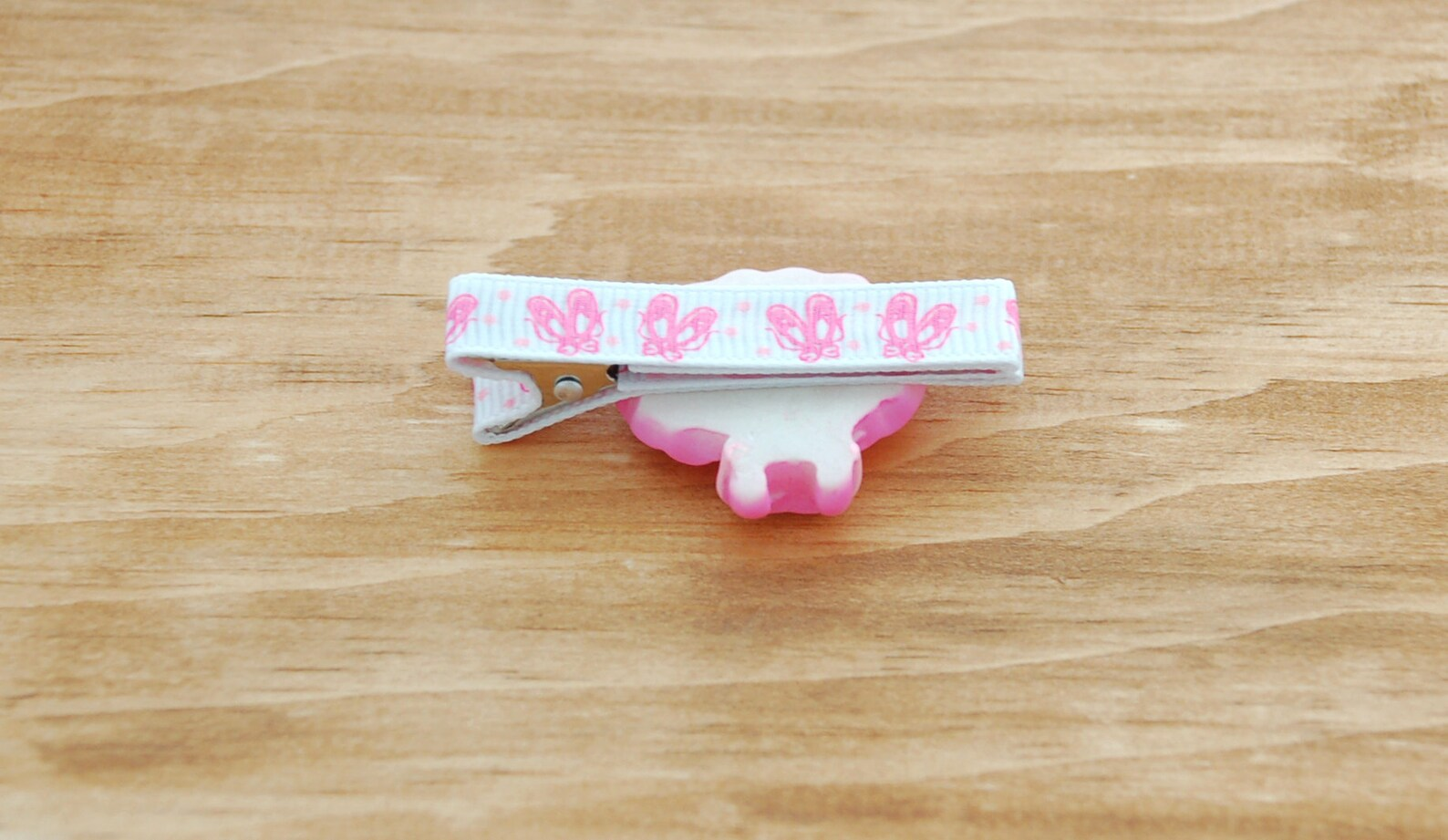 girls barrette fully lined on a double prong alligator clip in white grosgrain with pink ballet slipper and pink tutu embellishm