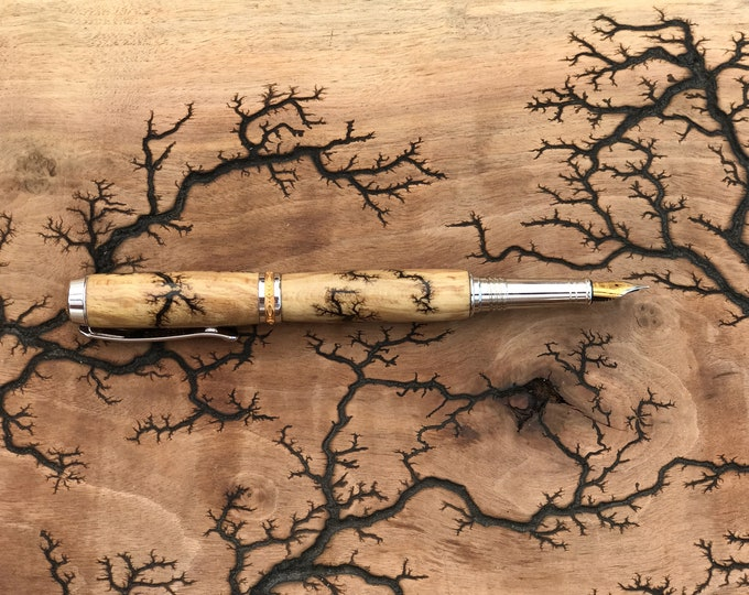 Featured listing image: Electrocuted Wood Fountain Pen