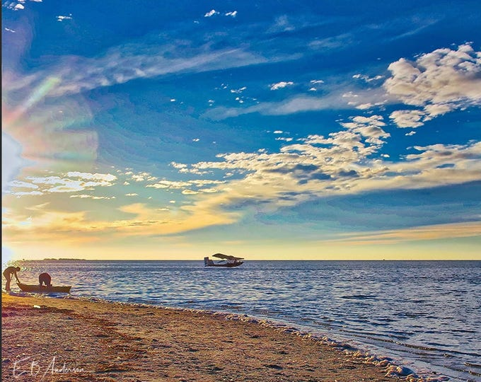 Featured listing image: Float plane and kayakers at Sunset Beach, Tarpon Springs Florida