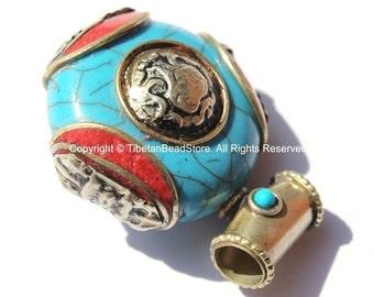 Tibetan Reversible Round Blue Copal Resin Pendant with Turquoise, Coral Inlays, Repousse Auspicious Conch & Vajra Details - Tibetan - WM6092