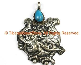 Ethnic Tribal Nepal Antique Look Repousse Tibetan Silver Guardian Deity Pendant with Turquoise Inlay - Nepal Tibet Jewelry - WM7205
